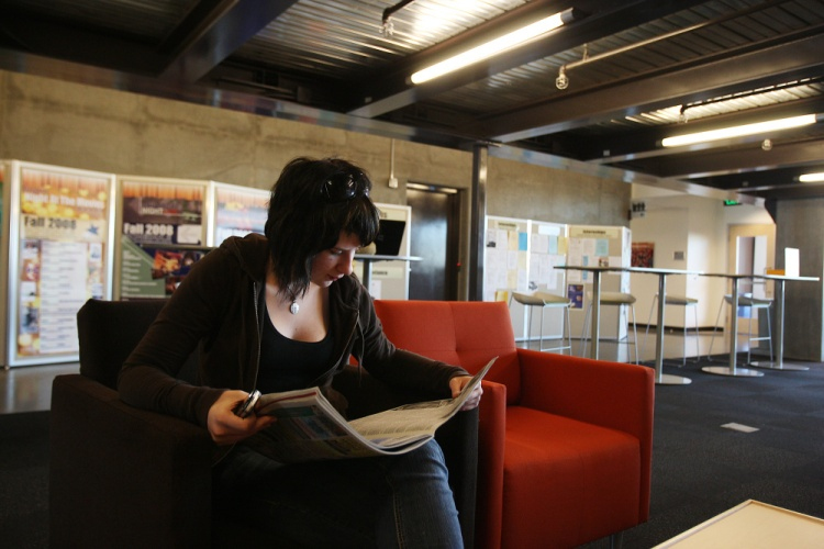 Rosalinda Albrecht, a journalism student, reads the morning paper at the Walter Cronkite School of Journalism and Mass Communication, at the new downtown campus of Arizona State University. (AP Photo/Ross D. Franklin)